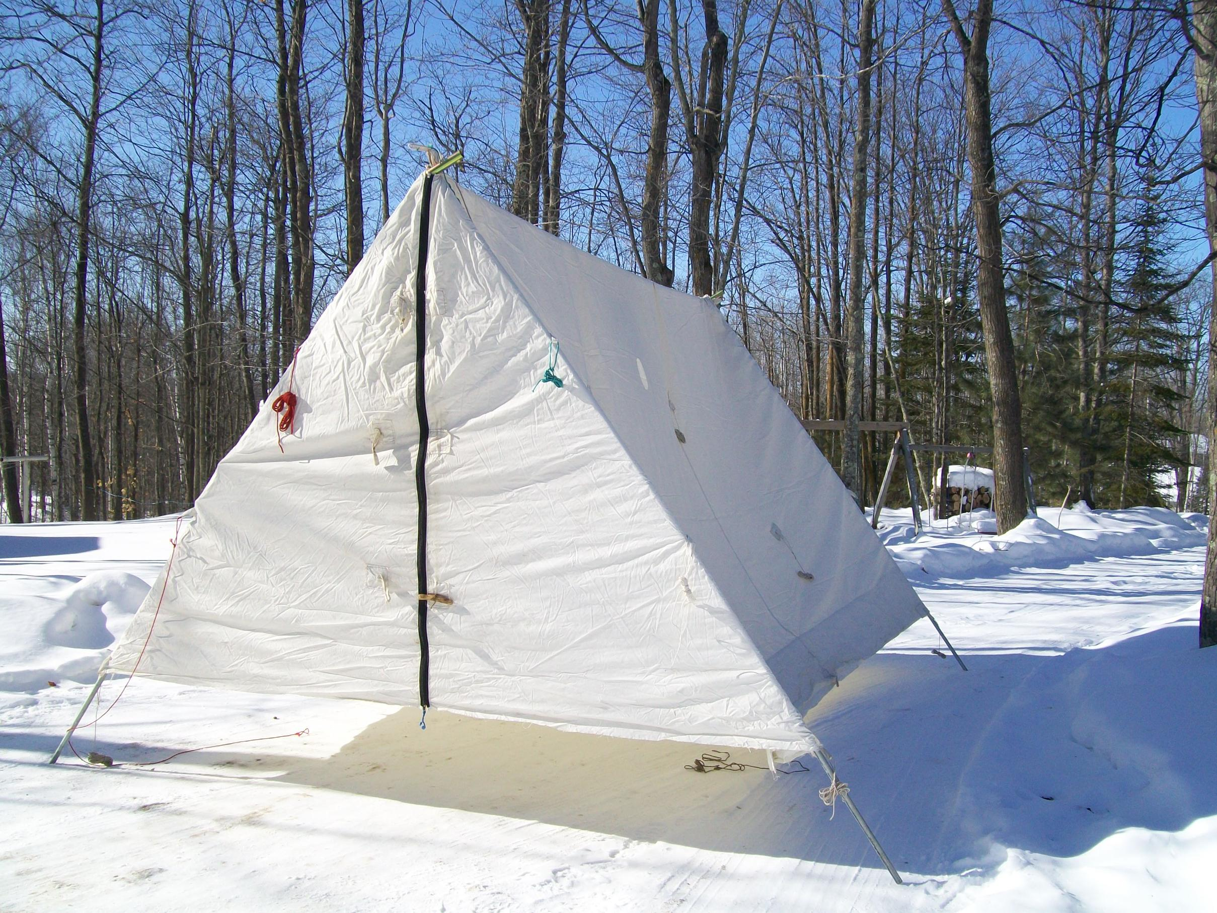 This is a picture of our tent essentially a wedge tent. We now have nylon snow flaps. The metal frame has also obviously been shortened. & BWCA heating nylon tents Boundary Waters Winter Camping and Activities