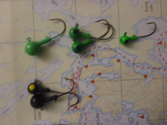Assorted black and green jigs