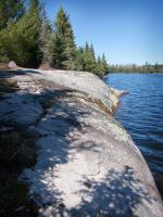 Rock ledge at portage landing on the Gull Lake side of portage to Home Lake.