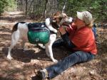 Katy, with fully loaded dog pack, enjoys a moment with Heidi.