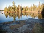 Sun rises on crisp morning at campsite on Quadga Lake.