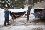 Nicole and Mike Nelson unload the dogsled at the Clearwater Lake landing.