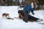 Nicole prepares the dogsled as Titus comes to help.